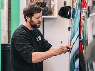 jay wrapping a bespoke van